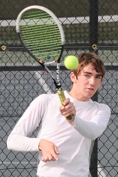 by: LON AUSTIN/CENTRAL OREGONIAN - Jack Stubblefield plays a forehand winner in his No. 2 singles match against the Ravens. Stubblefield won his match against Brett Blundell 7-6, (8-6), 1-6, 10-7.