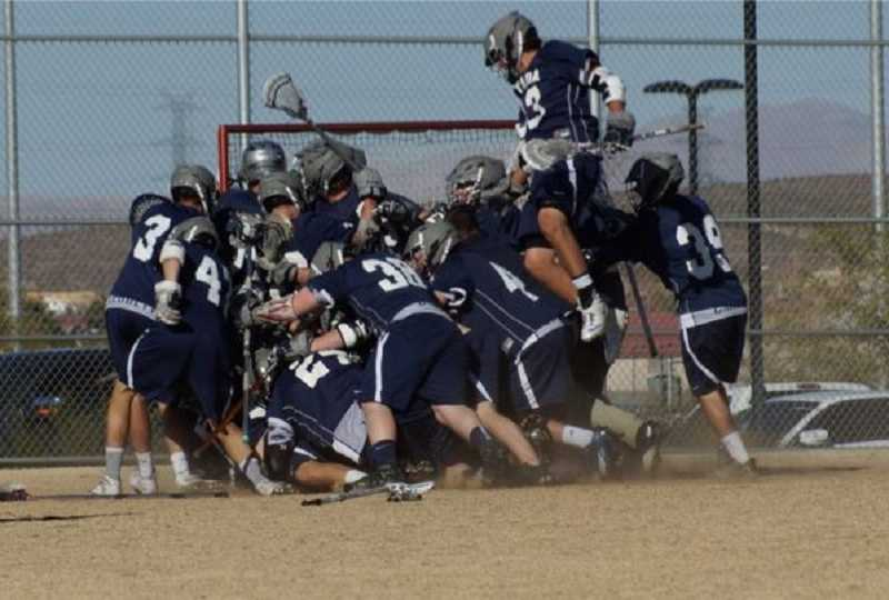 by: SUBMITTED PHOTO - Wilsonville alumnus Jeremey Wetherbee (second from right) jumps in celebration after the Nevada men's lacrosse team defeated UNLV in a rivalry game this season. The Wolf Pack went on to win a Division II league title.