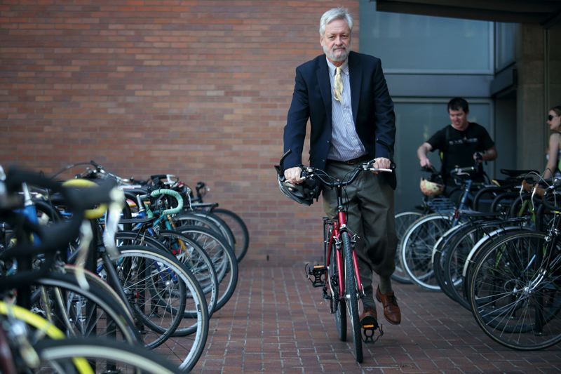 by: PAMPLIN MEDIA GROUP: JONATHAN HOUSE - Robert Liberty glides on a bike at the Urban Plaza at Portland State University.