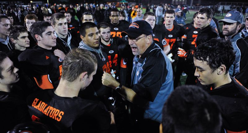 by: JOHN LARIVIERE - Retired Gladstone football coach Jon Wolf rallies the troops following a home victory last fall. Wolf, 55, is leaving Gladstone after eight seasons as head coach, but he says hed like to continue teaching and coaching part-time somewhere.