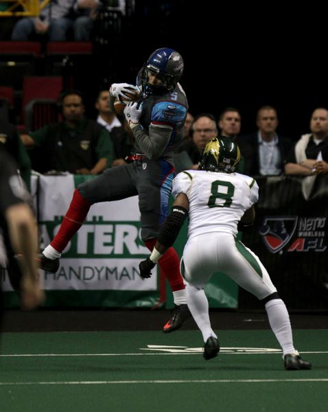 by: TRIBUNE PHOTO: JONATHAN HOUSE - The Portland Thunder are 2-6 in their maiden Arena Football League season. The offense has gotten off the ground more of late, though, with a receiving corps that is still learning the game and includes Justin Monahan, a former Portland State Viking making a catch against San Jose.