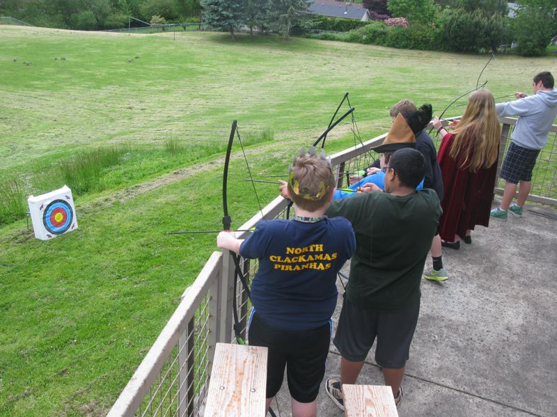 by: PHOTO BY: RAYMOND RENDLEMAN - Rowe students to practice their archery behind the school.