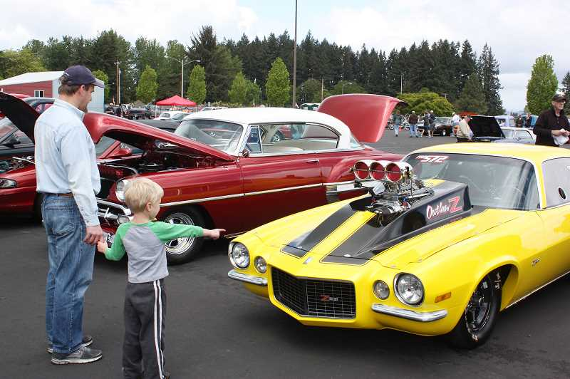 by: NEWS-TIMES PHOTOS: DOUG BURKHARDT - Dozens of unique cars were on display in Cornelius Saturday for the annual Papas Toys fundraiser for Portlands Doernbecher Childrens Hospital. Adults and kids alike seemed to enjoy seeing the varied display of classic cars.