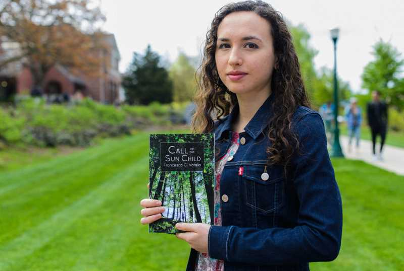 by: SUBMITTED PHOTO - Francesca Varela shows her new novel, 'Call of the Sun Child.' She will be reading from it June 21 at the young writers workshop at Marylhurst University.