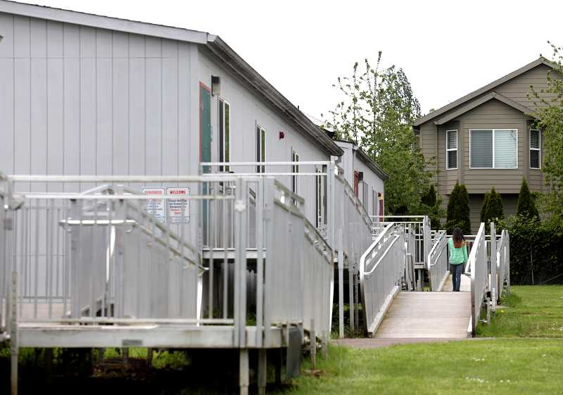 by: TIMES PHOTO: JONATHAN HOUSE - Vose Elementary School houses about a third of its classes in seven portable classrooms, creating the need for students to shuffle back and forth between them and the main building.