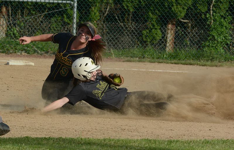 by: JOHN WILLIAM HOWARD - Junior Michelle Sass is tagged out as she slides into second in the third inning of the Lions' 5-2 loss to Putnam on May 14.