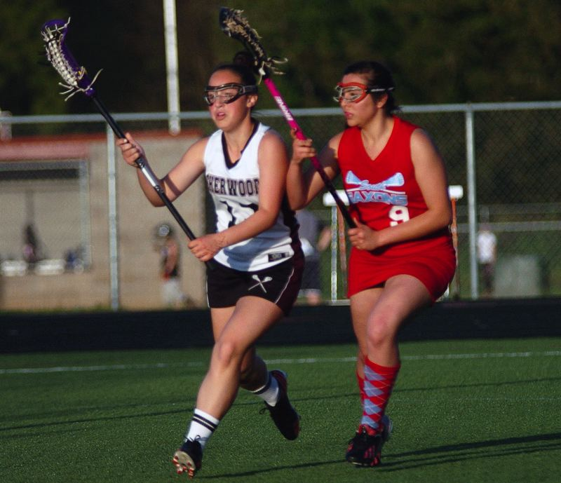by: DAN BROOD - ON THE MOVE -- Sherwood freshman Kendra Ellertson (left) looks to drive against a South Salem player late in Monday's state playoff game. The Lady Bowmen got a 15-5 win.