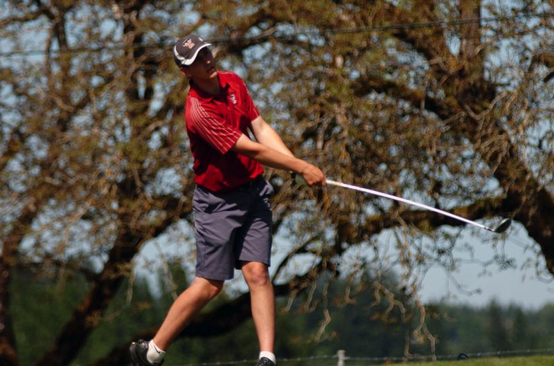 by: DAN BROOD - THERE IT GOES -- Tualatin High School senior J.J. Paulson watches his drive on hole No. 17.