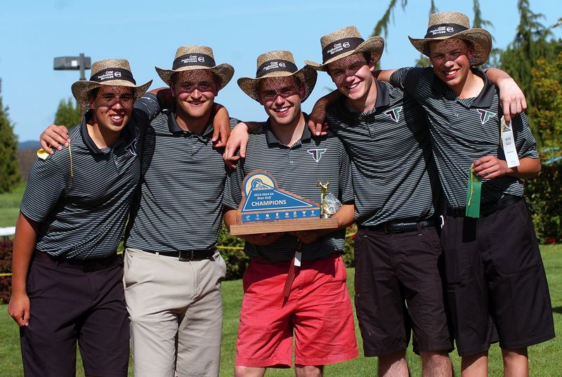 by: DAN BROOD - THE CHAMPS -- Tigard's (from left) Colin McAninch, Corey Floom, Damien Vonahelfeld, Nick Jones and Jon Holzgang claimed the Pacific Conference championship trophy.