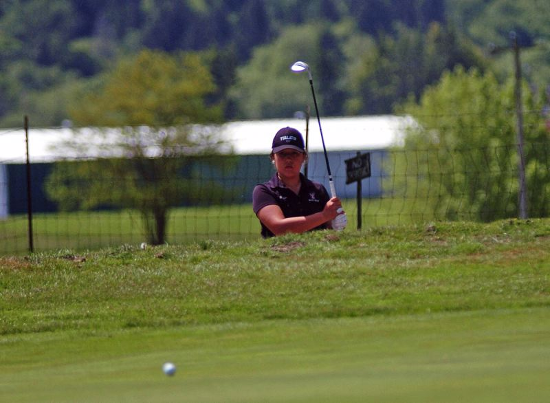 by: DAN BROOD - NICE SHOT -- Tualatin's Janelle Decker puts her bunker shot onto the green during Monday's action at the Pacific Conference girls golf tournament.