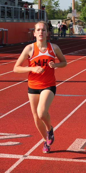 by: JIM BESEDA/MOLALLA PIONEER - Molalla's Brianna Loughridge, pictured here running the 800 at last week's final regular-season home meet, successfully defending her district title in the girls' 3,000-meter run during Friday's finals at North Marion High School.
