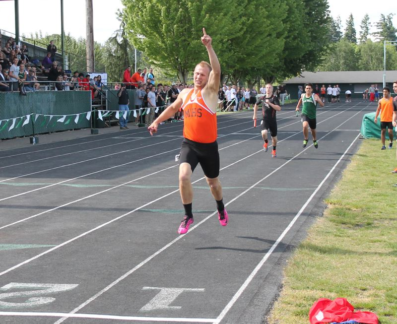 by: JIM BESEDA/MOLALLA PIONEER - Molalla's Brody Olson brings home the baton in the boys' 4x400 relay in a winning time of 3:31.20 at Saturday's Tri-Valley Conference track and field district championships.