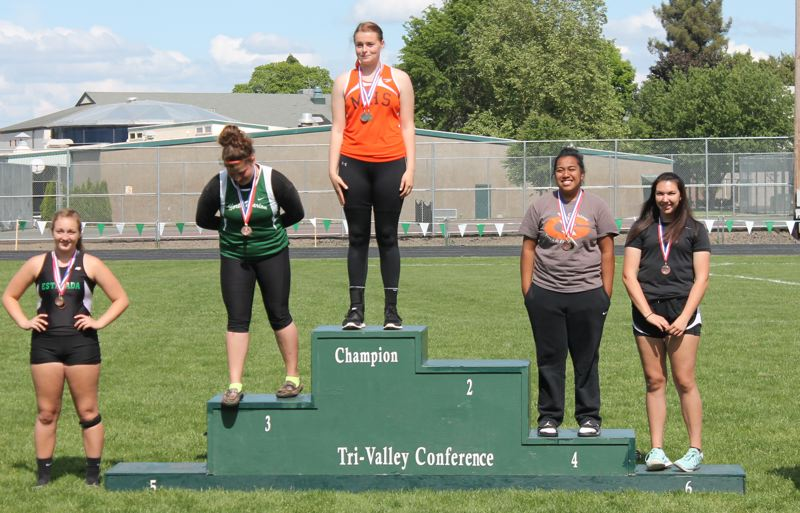 by: JIM BESEDA/MOLALLA PIONEER - Molalla freshman Rachel Bring won the girls' shot put with a throw of 33 feet, 11 inches at Saturday's district championships at North Marion High School.