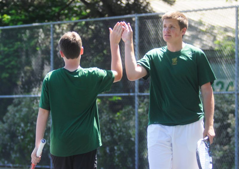 by: MATTHEW SHERMAN - West Linn doubles partners Matt Perkins, left, and Mitch Tingey earned the No. 2 seed at districts and easily advanced to the semifinals, earning a state berth.