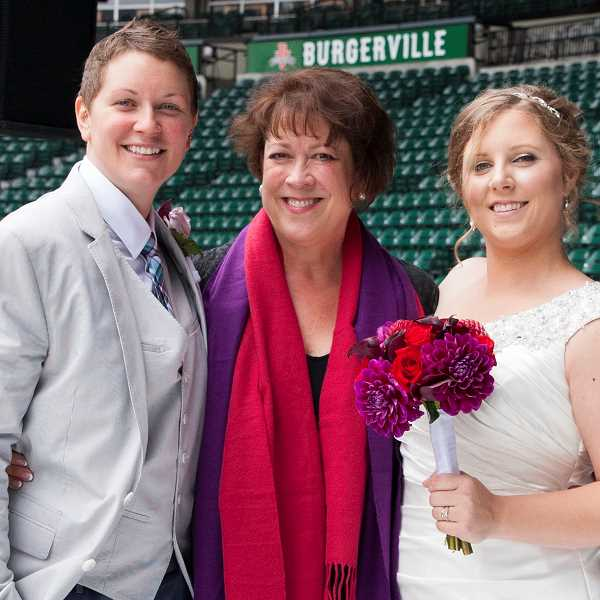 by: SUBMITTED PHOTO - Officiant Melissa Coe of Melissa Coe ceremonies, stands with her clients Sarah and Kate.
