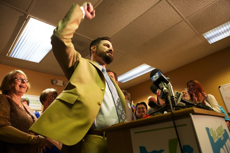 by: TRIBUNE PHOTO: JAIME VALDEZ - Federal lawsuit plaintiff Ben West celebrated Monday afternoon after a federal judge struck down Oregon's 10-year ban on same-sex marriage.