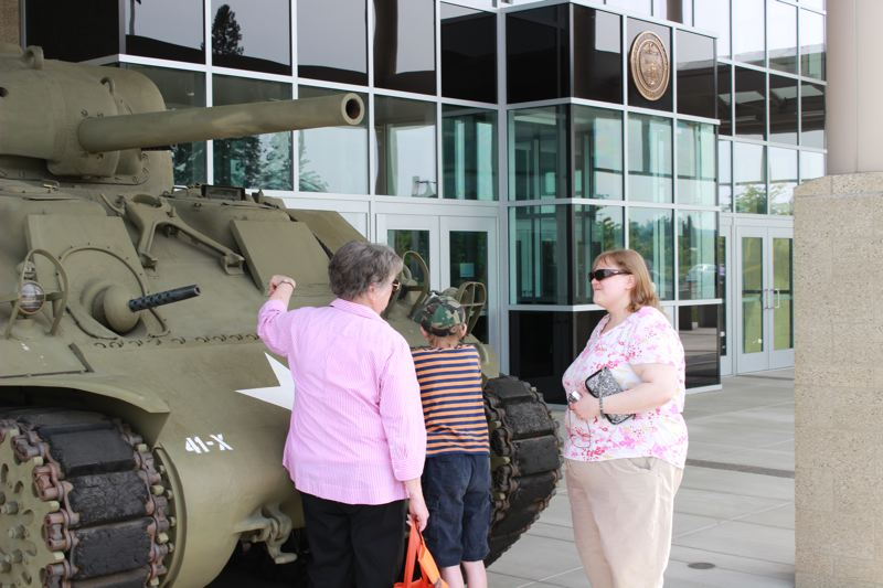 by: PHOTO BY: COREY BUCHANAN - Dea Begert (from left), Paul Schnedler and Anna Schnedler check out a historic tank outside of the Camp Withycombe military base in Clackamas.