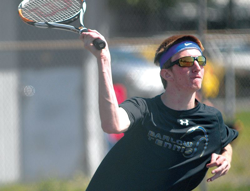 by: THE OUTLOOK: DAVID BALL - Barlows Parker Joncus waits on an overhead at the net. He was part of one of three Bruin teams to reach the doubles semifinals.