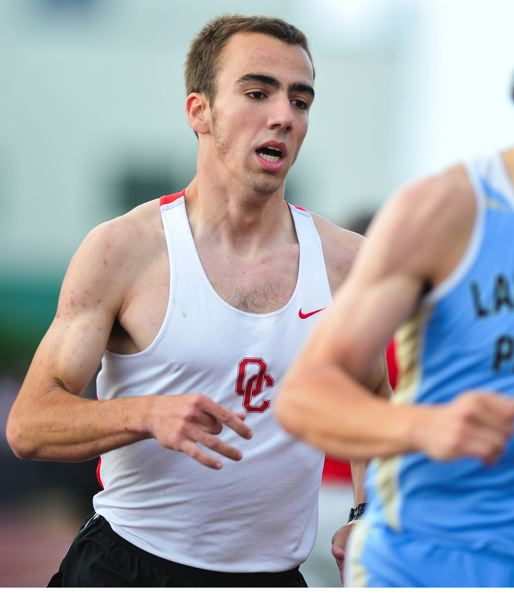 by: JOHN LARIVIERE - Oregon City senior Al Lacey was tough in the distance race at the 2014 Three Rivers League district track and field meet