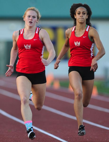 by: JOHN LARIVIERE - Becca Houk (left) and Karrin Shriner excelled in the sprints at last weeks Three Rivers League District Meet, advancing to state in the 100, 200 and in the sprint relay. The two senior talents rank one-two on Oregon City High Schools list of all-time best female sprinters.