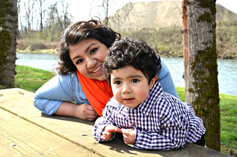 by: MARIAANNA KURTS - Shirley Bravo Gonzalez, pictured with her 2-year-old son Christopher, rejected the stereotype of being a teen parent, not only by continuing her education and maintaining a 3.5 grade point average, but also by being named one of 1,000 minority students nationwide to receive the Gates Millennium Scholarship, which provides full tuition to any university in the United States.