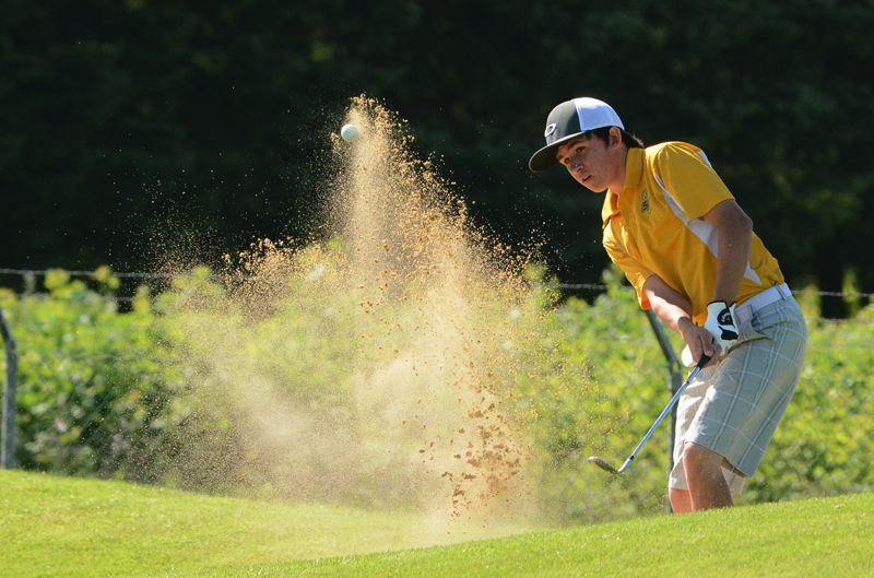 by: JOHN WILLIAM HOWARD - Junior Michael Hewlett chips out of a bunker near the green on the 18th hole at Quail Valley Golf Course, nearing halfway through with his second round of the Class 5A state tournament. Hewlett shot an 86 on Tuesday, helping the Lions to secure a 9th place finish.