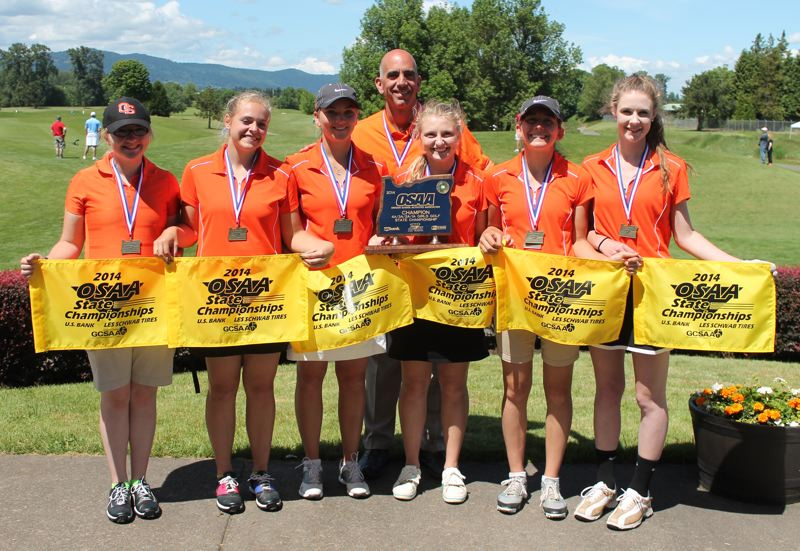 by: JIM BESEDA/MOLALLA PIONEER - The Molalla girls' golf team poses with coach JD Clarizio after winning a fifth consecutive OSAA Class 4A/3A/2A/1A state championship Tuesday at Trystring Tree Golf Course in Corvallis.