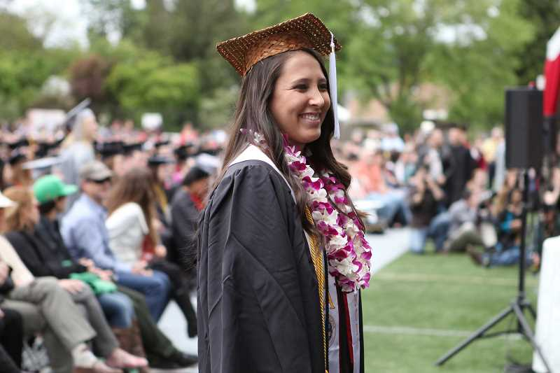 by: COURTESY PHOTO - Outstanding Senior in Social Sciences Charlotte Basch smiles for the camera on graduation day at Pacific University.