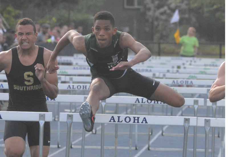 by: TIMES PHOTO: MATT SINGLEDECKER - Jesuit sophomore hurdler Julian Body won the 110-meter hurdles at Metro League District Championship on Friday.