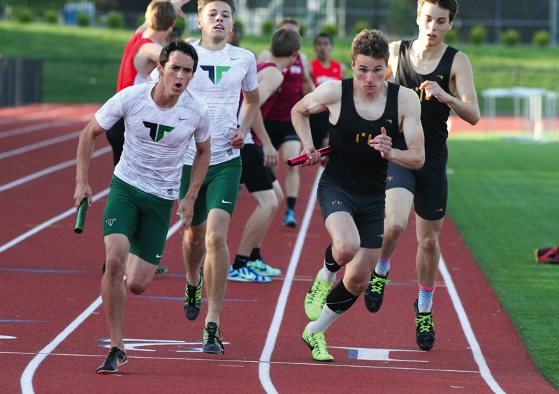 by: NEWS-TIMES PHOTO: AMANDA MILES - Forest Grove's Geremia Lizier-Zmudzinski (right) and Tigard's Tyler Powers go head-to-head in the 4x400-meter relay last Friday.