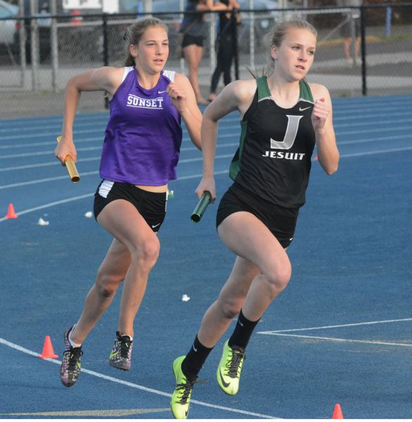 by: TIMES PHOTO: MATT SINGLEDECKER - Jesuit's Abby Wachter and Sunset's Nicole Griffiths were neck-and-neck down the stretch of the 4x400 relay with the Apollos eventually taking first overall.