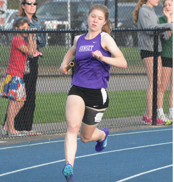 by: TIMES PHOTO: MATT SINGLEDECKER - Sunset sophomore Kasey Stavigs strong second leg of the 4x400 relay helped the Apollos edge past Lincoln in the final race of the Metro League District Championship.