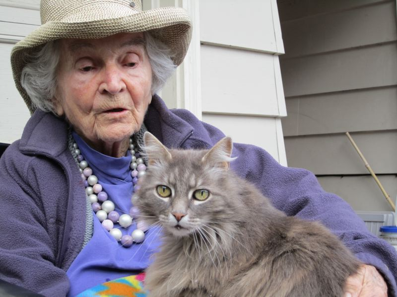 by: CONTRIBUTED PHOTO - Carol 'Althea' Halvorson relaxes with 'Zin Zin,' one of her favorite neighborhood cats, before her death at age 98 in January. The longtime West Slope resident endeared herself to neighbors with her gentle but focused dedication to social justice and civil rights issues.