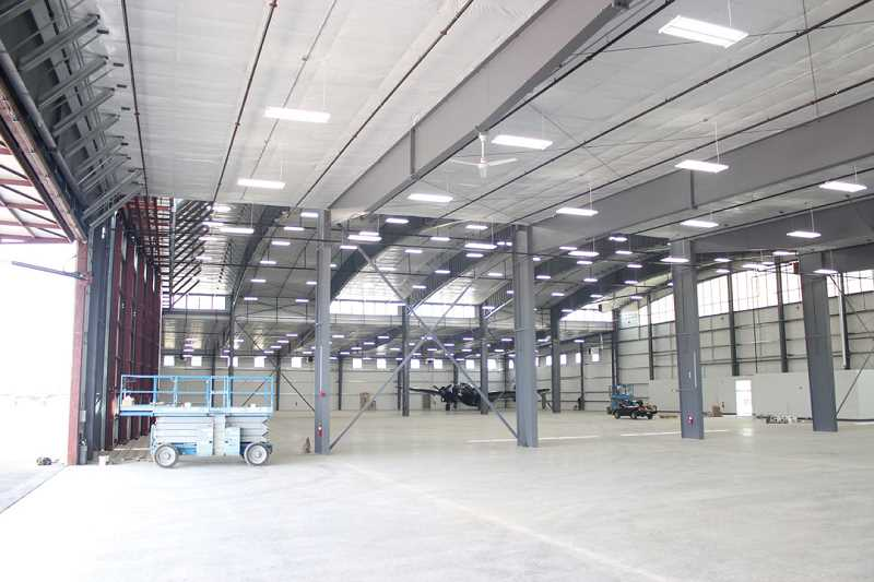 by: HOLLY M. GILL - The spacious interior of the new Erickson Aircraft Collection Facility is large enough to house 25 or more aircraft. The facility was expected to be completed this week.