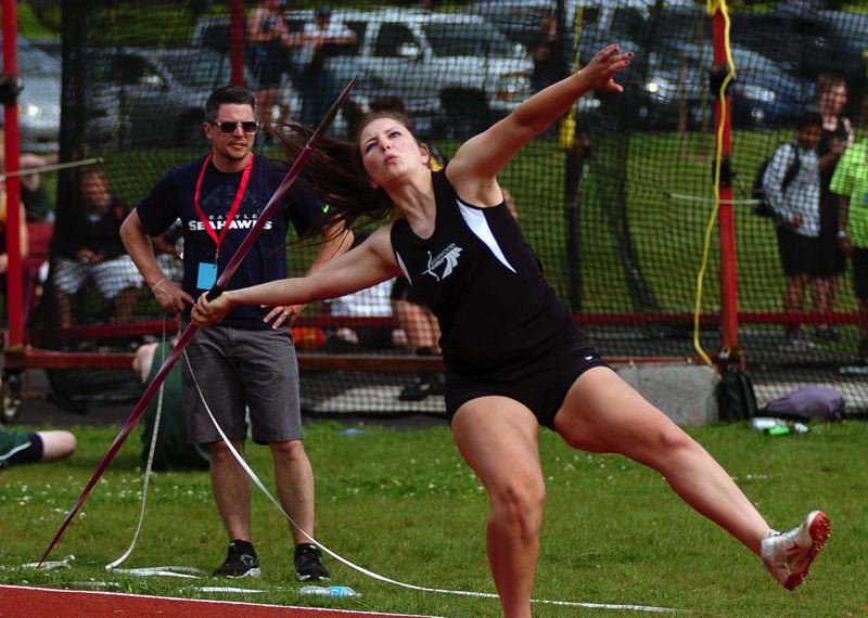by: DAN BROOD - LET IT GO -- Sherwood High School senior Elyse Cuthbertson gets ready to let the javelin fly last Thursday during the first day of the Northwest Oregon Conference district meet.