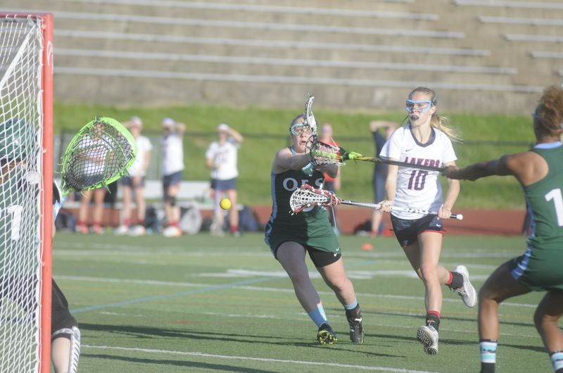 by: MATTHEW SHERMAN - Lake Oswego's Madison Focht fires a shot past the OES goalie during Monday's state semifinal game. Focht had five goals in the contest to lead the Lakers.