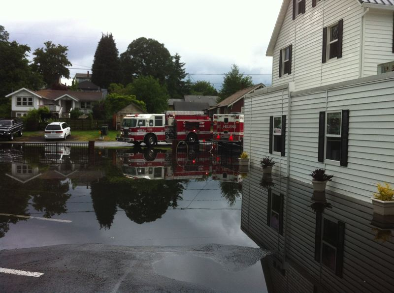 by: COURTESY OF COLUMBIA RIVER FIRE & RESCUE - Columbia River Fire & Rescue crews respond to flooding outside the Columbia Funeral Home & Cremation Center Sunday, May 18.
