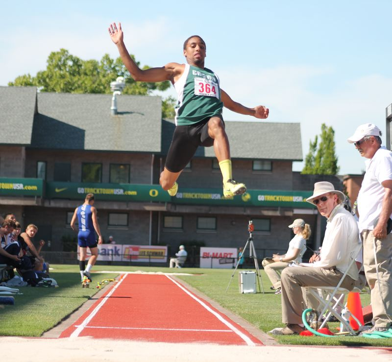 by: JIM BESEDA/MOLALLA PIONEER - Colton's Malik Knott won the Class 3A boys' long jump state title with a leap of 21 feet, 7 3/4 inches during Thursday's final of the OSAA track and field championships at Hayward Field in Eugene. Knott, a sophomore, had four marks over 21 feet, including all three in the finals.