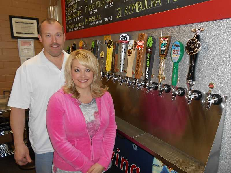 by: REVIEW PHOTO: CLIFF NEWELL - Mark and Kristi Becker have brought Flyboy Brewery to Lake Grove, and everyone who tries it likes it.