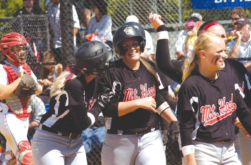 by: THE OUTLOOK: PARKER LEE - Mercedes Green is greeted at the plate after her go-ahead home run in Mondays championship game.