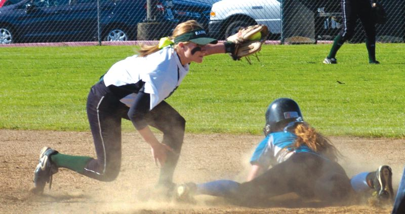 by: THE OUTLOOK: PARKER LEE - Reynolds infielder Elle Stanfill tags out a Century base runner during Tuesdays 9-2 win in the play-in qualifier game.