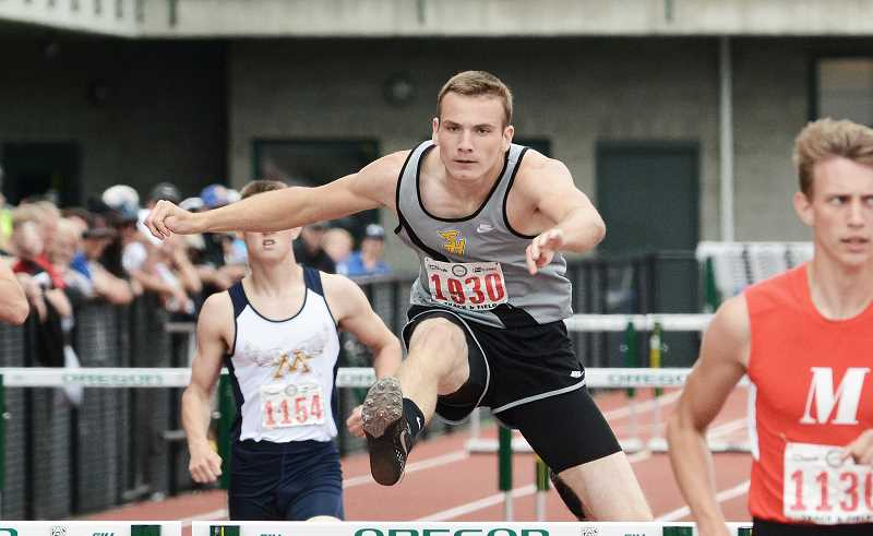 by: JOHN WILLIAM HOWARD - St. Helens senior Thomas Hughes qualified for both the 110 and 300 meter hurdle finals at the OSAA 5A Track and Field championships in Eugene.