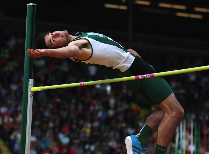 by: TRIBUNE PHOTO: JONATHAN HOUSE - Tristan Anastas clears 6-foot-6 in the Boys 5A High Jump on his way to first place.