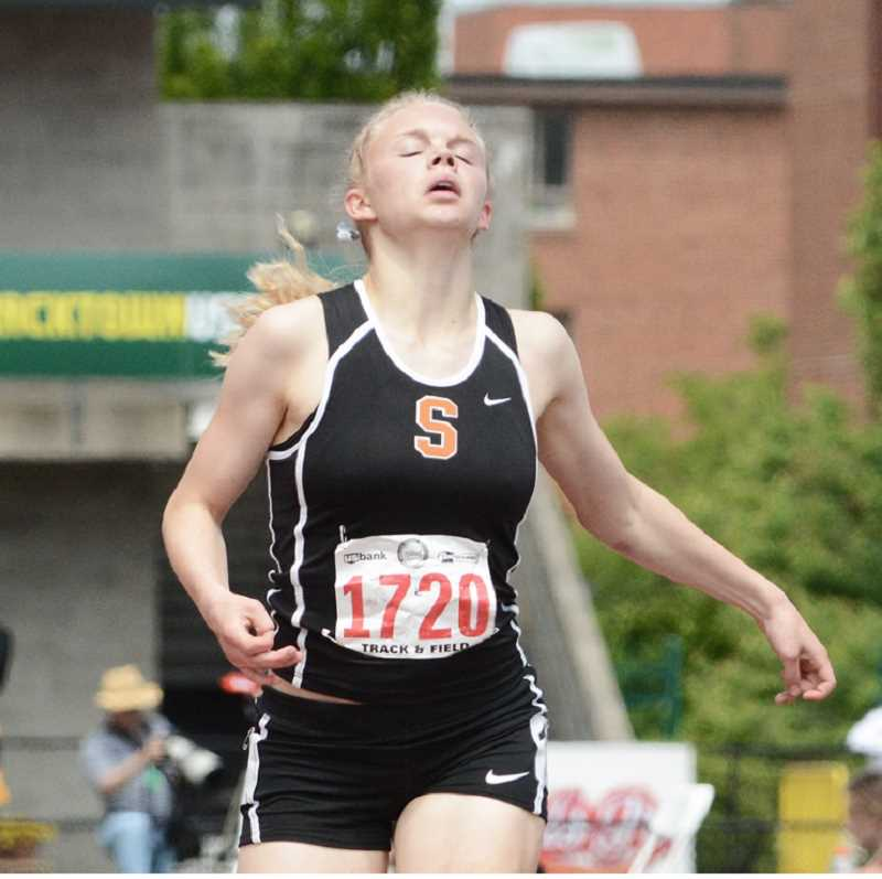 by: JOHN WILLIAM HOWARD - It took every once of energy she had, but senior Charlie Davidson was able to outdistance the pack to take her second 1500 meter state title, repeating after winning the event in her freshmen season.