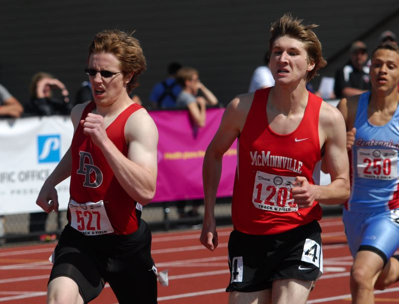 by: THE OUTLOOK: DAVID BALL - David Douglas junior Joshua Kellebrew charges into the lead for good on the final turn of Saturdays 800-meter final.
