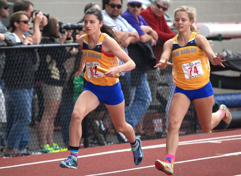 by: THE OUTLOOK: DAVID BALL - Barlows Macie Allen gets rid of the baton to Renick Meyer in the first exchange of the 400-meter relay Saturday. The Bruins won in 47.74 seconds.