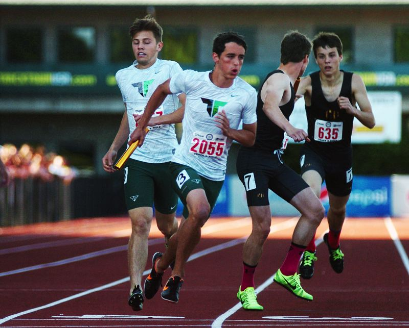 by: DAN BROOD - Tigard junior Tyler Powers (2055) takes off after getting the baton from senior Martin Ramos III in the boys 4 x 400 relay event.