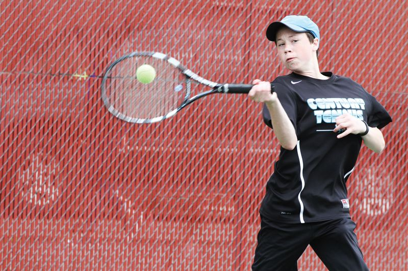 by: HILLSBORO TRIBUNE PHOTO: AMANDA MILES - Century sophomore Tommy Edwards hits a forehand during the Pacific Conference district tennis tournament Saturday at Linfield College.