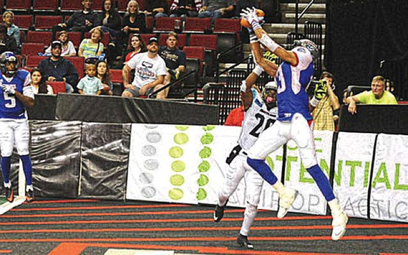 by: COURTESY OF PORTLAND THUNDER - Eric Rogers, wide receiver for the Portland Thunder, has played only a few games for the Arena Football League team, but he already has distinguished himself with tough catches and scoring plays.