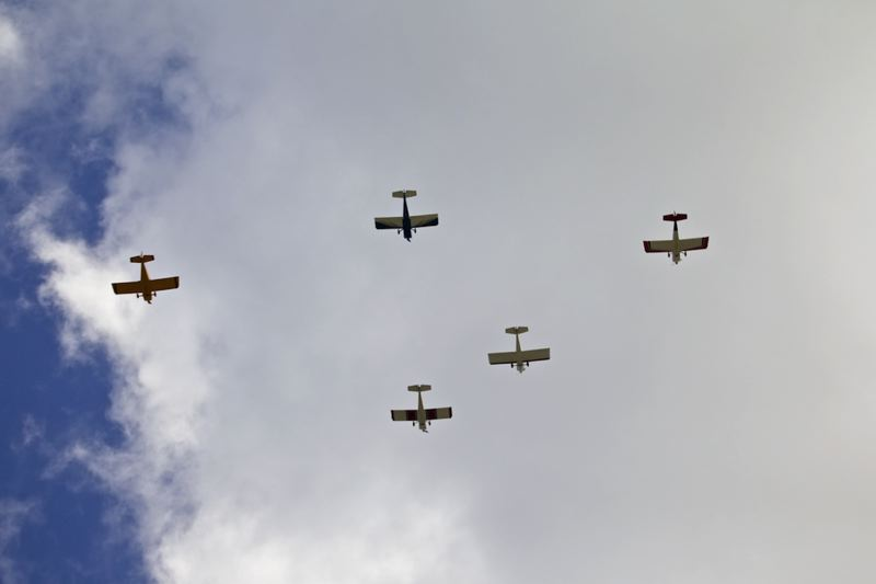 by: TIMES PHOTO: JAIME VALDEZ - Members of the West Coast Ravens Team with RV-8 special aircraft perform a missing pilot flyover to open Beaverton American Legion Post 124's annual Memorial Day Program in Beaverton Veterans Memorial Park.